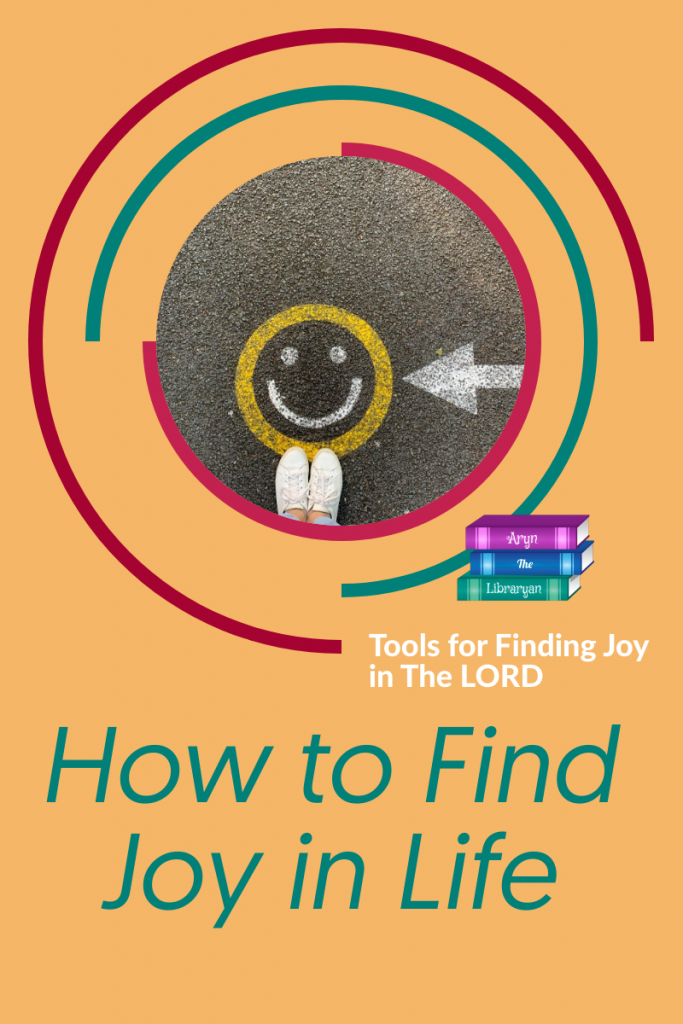 How to find Joy in Life: Tools for finding Joy in the Lord.   Smiley face painted on a road for a background